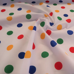 White with multicoloured spot polyester cotton, white multi spot polycotton, primary colours spot fabric, multi spot polycotton, multi coloured polka dot fabric